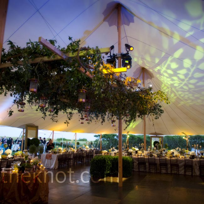 JoAnn brought the feel of an outdoor garden patio inside this tent with a lush ceremony arbor.