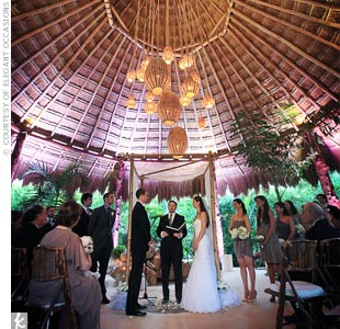 For this destination wedding in Mexico, JoAnn hung varying sizes of woven lanterns to cast a warm light over the couple.