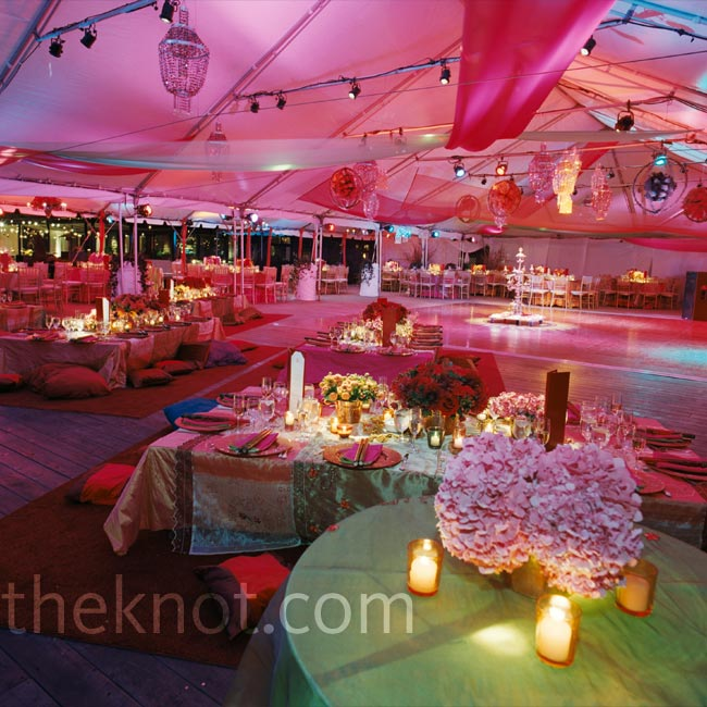Rich pink lighting softened the multicolored palette of this traditional Indian wedding.