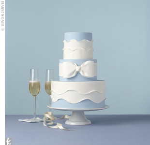 Soft ruffles and a sugar bow give this traditional wedding cake a