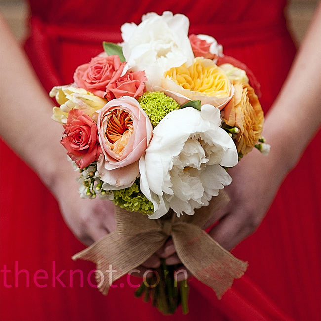 The bridesmaids carried small nosegays of peonies, roses, viburnum and ranunculus which perfectly accented their coral dresses.