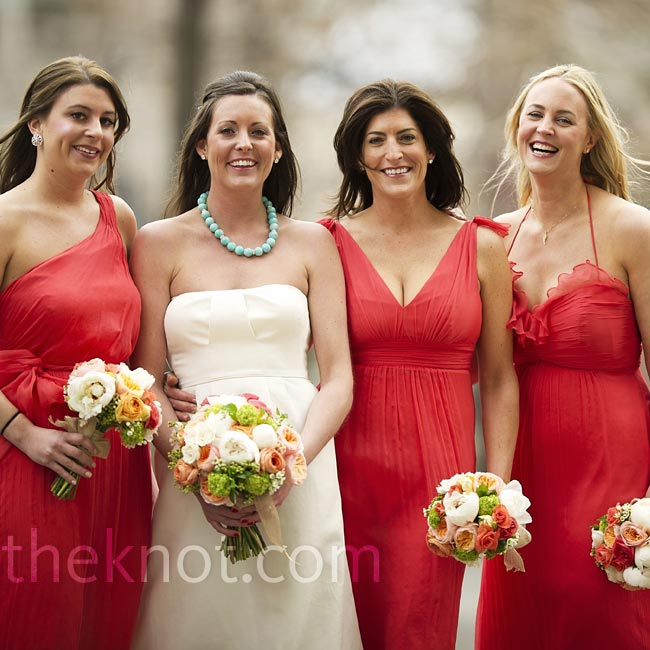 Instead of wearing identical dresses, the bridesmaids wore varying styles of salmon-hued Amsale gowns.