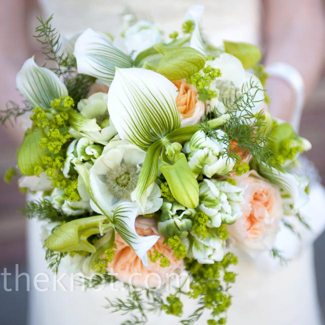 Lady slipper orchids were the star of Julia's bouquet and were set off by peach garden roses and greenery.
