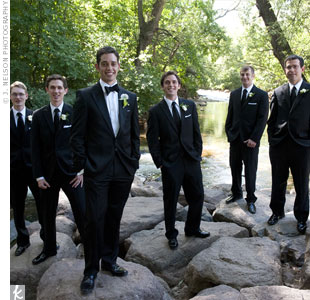 The groomsmen wore tuxes with white pocket squares and black straight ties, while Yair stood out in a traditional bow tie.