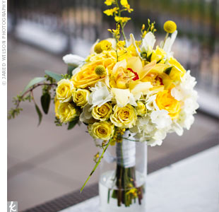 Kimberly's bouquet of yellow and white roses, orchids, hydrangeas and craspedia combined modern and rustic elements.