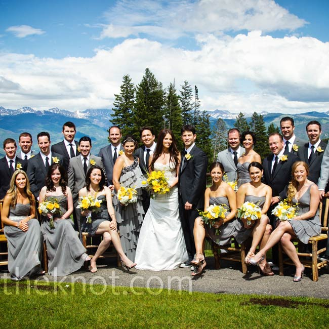 The bridesmaids chose different styles of graphite chiffon dresses and the groomsmen wore their own suits in shades of gray or charcoal.