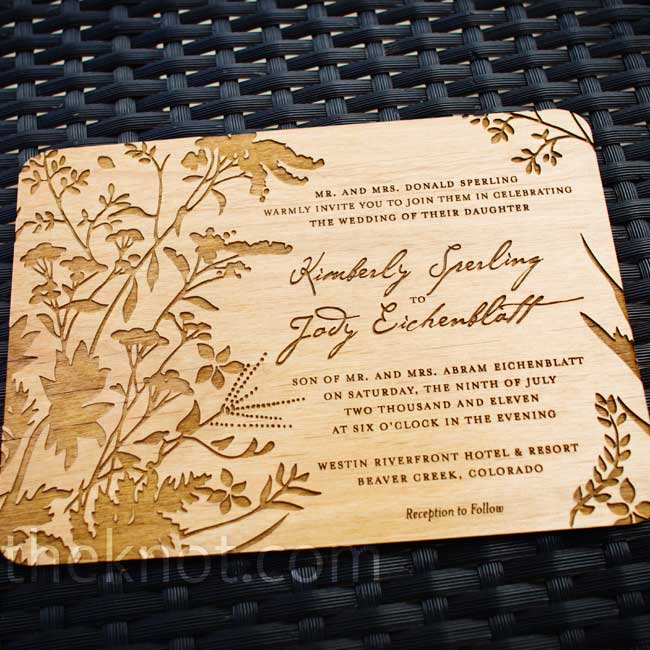 The custom-designed invitations were thin pieces of wood laser-engraved with a botanical theme.