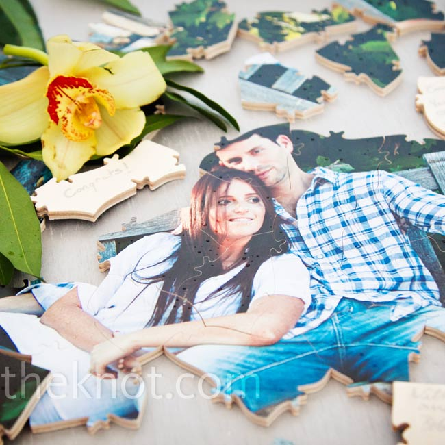 In lieu of a traditional guestbook, Kimberly and Jody had a puzzle created from a photo and invited friends and family to sign the backs of the puzzle pieces.