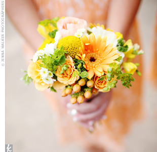 A loose grouping of dahlias, daisies, hypericum berries and craspedia gave the bridesmaid bouquets a relaxed, just-picked vibe.