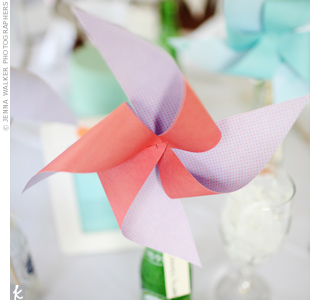 The couple handmade colorful pinwheel place cards, which sat in vintage soda bottles at each place setting.