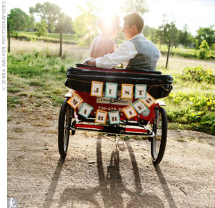 A bike and carriage delivered Kristen to the ceremony and was the perfect spot for a tender photo op later that evening.