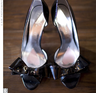 Lora wore black patent leather d'Orsay pumps that sported sassy bows.