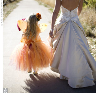 The flower girls wore orange tutu dresses with wings and flower headbands that they wore again as Halloween costumes.
