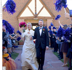 As Lora and Casey exited the church, guests waved purple pom-poms in honor of their alma mater, Kansas State University.