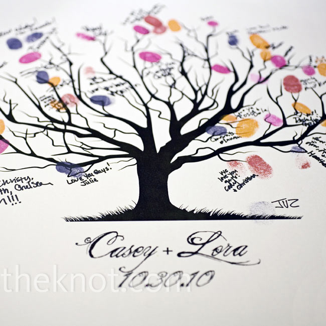 In lieu of a traditional guest book, guests left their mark by placing their fingerprints and signatures on a print of the tree used on the invitations.