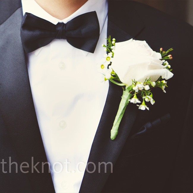Andy wore a simple ivory rose boutonniere.