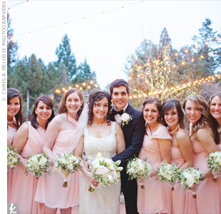 The bridesmaids wore varying styles of blush chiffon gowns.
