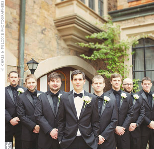The groomsmen looked sharp in their matching Giorgio Fiorelli tuxedos with black shirts and ties while Andy stood out in a white shirt and black tie.