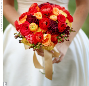 Katie chose dahlias, ranunculus and roses and accented them with coffee beans.
