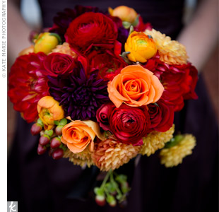 The bridesmaid bouquets were smaller versions of the bride's bouquet, accented with brown ribbon to match their dresses.
