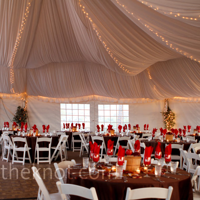 A dramatically draped white tent with twinkle lights was ideal for the dinner part of the reception.
