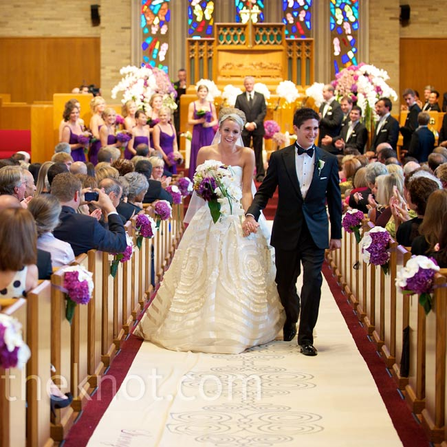 To match the elegant stained-glass windows of the church, a hand-painted runner ran the length of the 100-foot aisle.