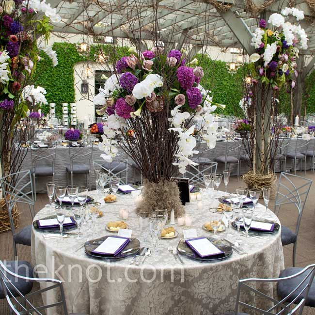 Silver linens and gray seat cushions provided a neutral background for the colorful centerpieces. The bridal party and the parents of the bride and groom were seated beneath a custom-made pergola.