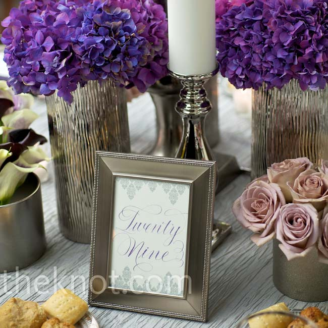 Each table number was written out in a script font and set in a pewter frame to match the vases and candlesticks on the tables.