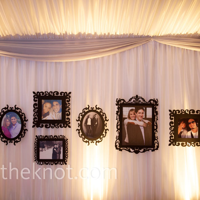 Andrea and Michael hung pictures of themselves in antique-looking frames for a personal touch.