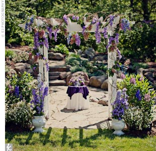 The couple exchanged vows beneath an arbor Becky's father built for the wedding. It was covered in purple flowers and greens for the lush, garden look they were after.