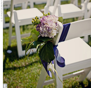 Ribbon, hydrangeas, leaves and berries marked every other aisle chair.