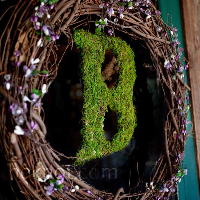 "A rustic grapevine wreath with a moss-covered ""B"" in the center decorated the door to the lodge."