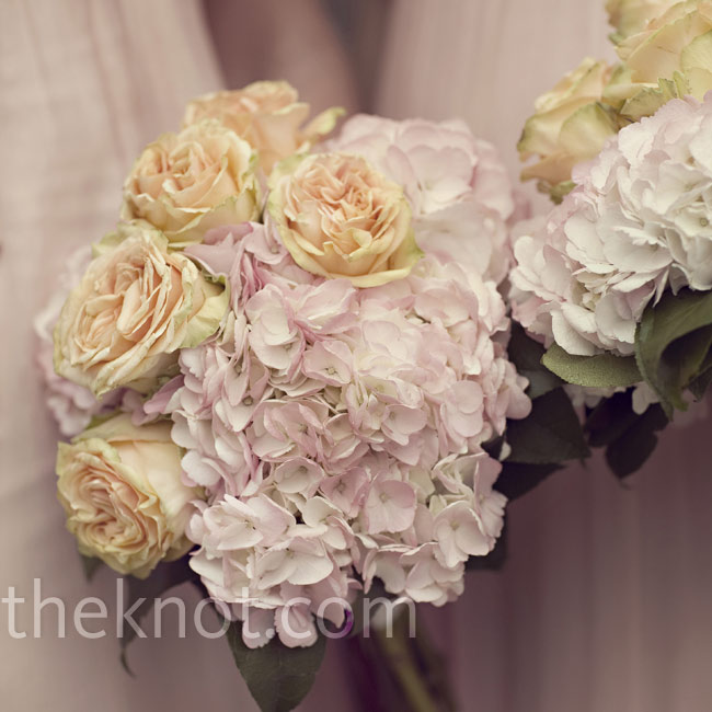 For a soft, romantic look, the bridesmaids carried antique-yellow tea roses and pale-pink hydrangeas.