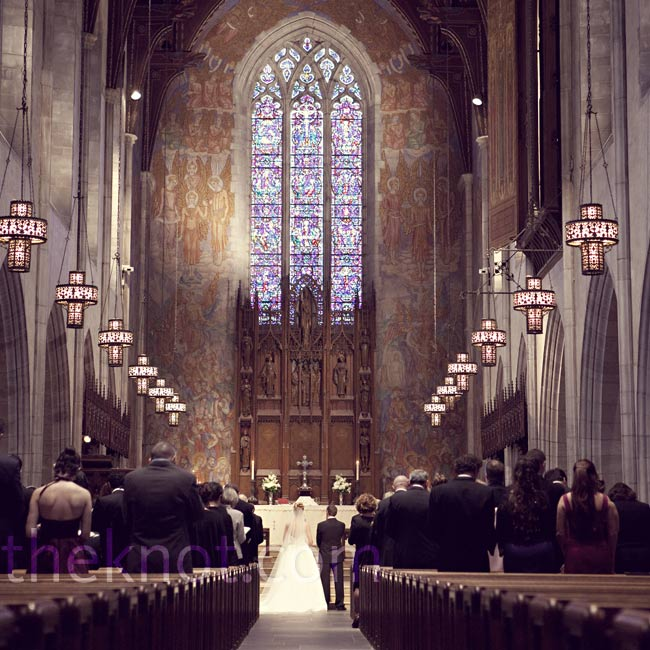The church didn't allow floral décor (other than two small arrangements at the altar), but with hand-carved wooden benches, stained-glass windows and a cathedral ceiling, flowers weren't necessary.