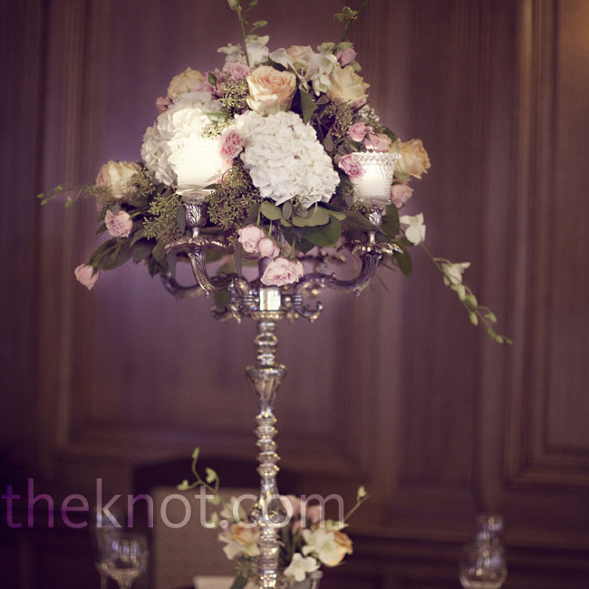 Candelabras filled with hydrangeas and roses topped the tables around the perimeter of the room.