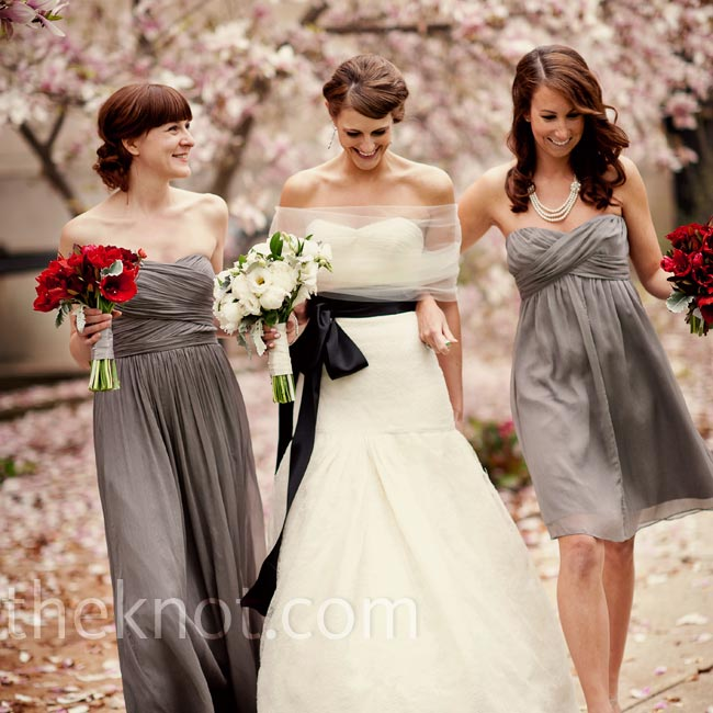 Lauren's sisters chose the same style of graphite dress in different lengths to suit their personalities.