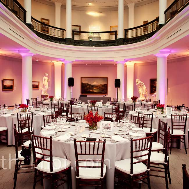Gray table linens and mahogany chairs with white cushions blended nicely with the museum's columns and marble floors.