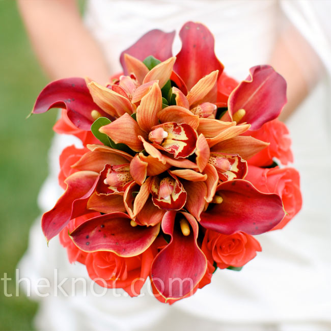 To contrast the paler shade of orange in the bridesmaid bouquets, Lori held a bright mix of roses, calla lilies and cymbidium orchids.