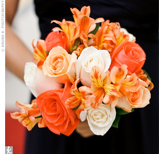 The bridesmaids carried orange roses and lilies.