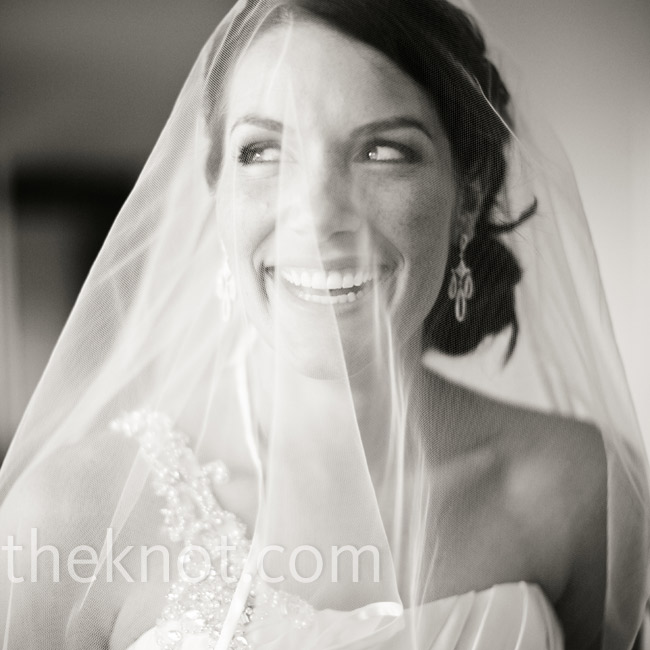 At the ceremony, Lori wore her hair in a loose, curled side bun with a veil.