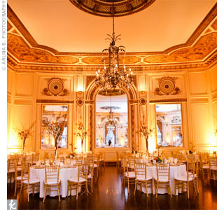 The couple amped up the elegant ambience of The Colony Club with uplighting carefully placed throughout the ballroom.
