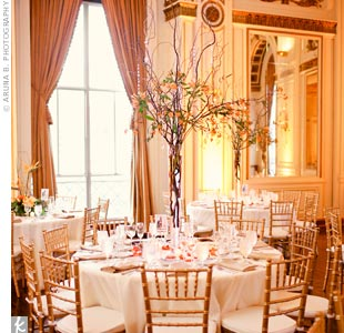 Taller centerpieces of curly willow branches added height to the room.
