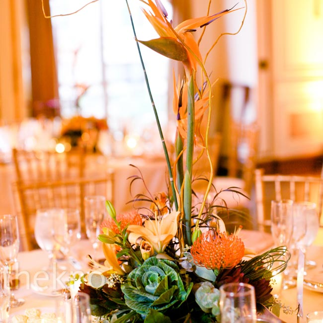 These funky arrangements were one of the two styles of centerpieces the couple had at their wedding. They included succulents, orchids, greens, bamboo and Birds of Paradise to really wow guests.