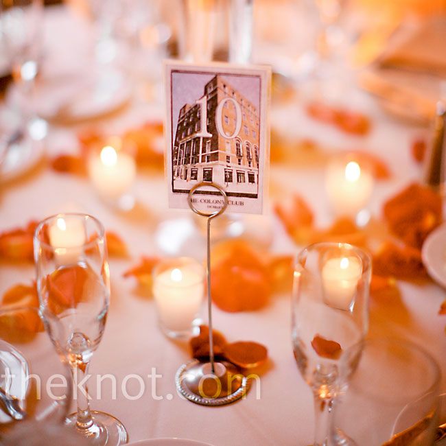 As a nod to the couple's roots, each table number was printed on a card with a Michigan landmark.