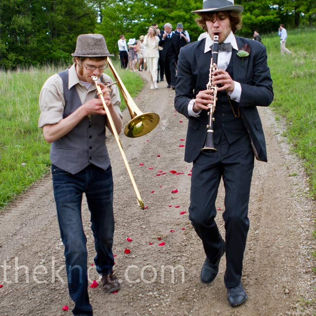 All of the guests took part in the wedding's parade processional. Some played trombones and flutes, and others played the kazoo.