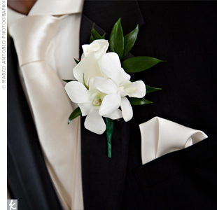 For a classic look, Jonathan wore a simple, all-white rose and dendrobium orchid boutonniere.