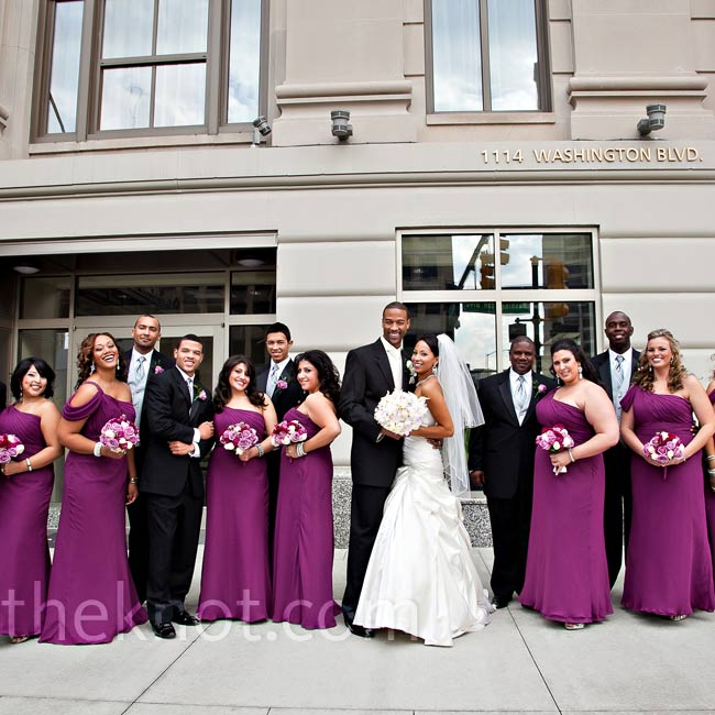 The bridesmaids wore floor-length, one-shoulder dresses, while the guys kept it classic in black tuxes.