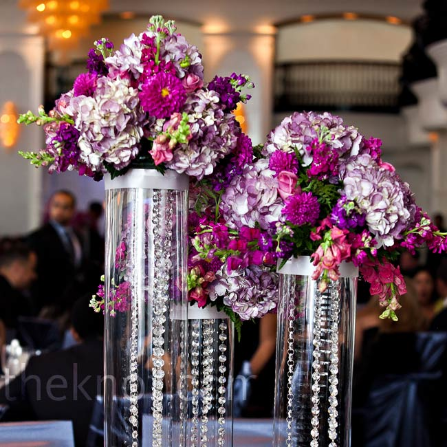 Groups of cylinders filled with hanging crystals and topped with hydrangeas, celosia, stock and roses adorned half of the tables.