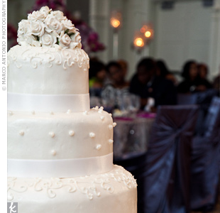 Inspired by Tatianna's dress, the ivory cake was decorated with sugar pearl dots and tiny sugar roses.