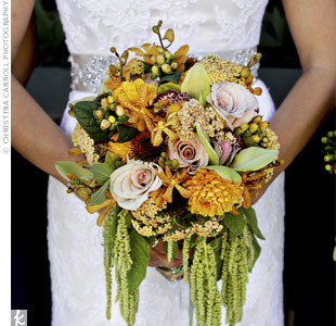 Anna carried a textured bouquet of cymbidium orchids, roses, ranunculus and hanging amaranthus.